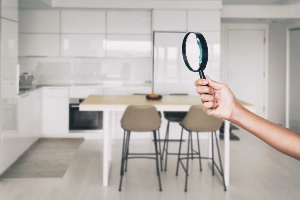 how to keep your house clean. A magnifying glass over a kitchen.