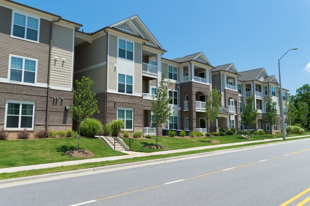 A row of apartments in a suburban complex Who is responsible for pest control in a rental property?